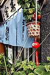 "A  glass wind chime, known as ""Edo furin,"" is hung outside a restaurant in Tokyo, Japan. The wind chimes date back more than 200 years, and is today still a common sound in the summer due to its cool clear ring that is said to induce mental coolness rather like the sound of clinking ice cubes in a tumbler."