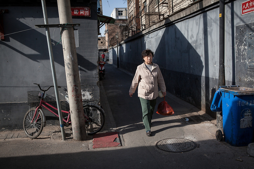 A resident walk the Hutong alleyway in Dongsi.