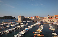 The old harbour of the medieval walled city, Dubrovnik, Croatia, developed by architect Paskoje Milicevic in the 15th century, with the 14th century Fortress of St John or Mulo Tower (left). Out to sea is Lokrum island. The city developed as an important port in the 15th and 16th centuries and has had a multicultural history, allied to the Romans, Ostrogoths, Byzantines, Ancona, Hungary and the Ottomans. In 1979 the city was listed as a UNESCO World Heritage Site. Picture by Manuel Cohen