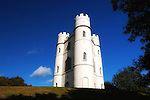 """Haldon Belvedere, Exeter, Devon..Built in 1788 by celebrated English cleric and politician Sir Robert Palk, the striking triangular structure, whose three points are marked by identical turret-topped towers, was visited by King George III, albeit late in his reign when he was suffering from an incurable mental illness. The construction of a local carriageway, simply called """"King's Road,"""" predates that visit, indicating that Palk probably had such a brush with royalty in mind."""