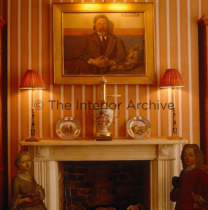 A portrait hangs above this mantelpiece which has porcelain plates and a samovar on display