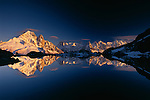 Panoramic of Les Drus and Les Aiguilles reflected in Lac Blanc, Chamonix