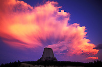Pink cloud over Devils Tower National Monument, Wyoming, USA