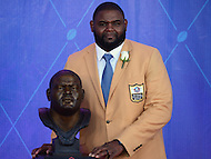 Canton, OH - August 6, 2016: Former NFL player Orlando Pace poses with his bust after giving his speech at the Pro Football Hall of Fame Enshrinement Ceremony in Canton, Ohio, August 6, 2016. Pace played 13 seasons in the NFL and was selected to the Pro Bowl  seven times. (Photo by Don Baxter/Media Images International)