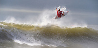 LONG BEACH, NY - SEPTEMBER 8: Owen Wright launches an aerial in Round 3 of the 2011 Quiksilver Pro New York on September 8, 2011 in Long Beach, NY. He would go on to defeat Kelly Slater in the final round to win the inaugural ASP World Tour event.