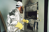 Crematory worker wearing protective clothing