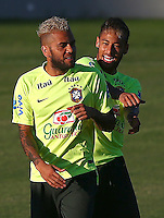 Neymar and Dani Alves of Brazil joke around during training ahead of tomorrow's World Cup quarter final vs Colombia tomorrow