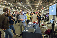 Workers from Fitland speak to attendees at the TechDay New York event on Tuesday, April 18, 2017. Thousands attended to seek jobs with the startups and to network with their peers. TechDay bills itself as the U.S.'s largest startup event with over 500 exhibitors. (© Richard B. Levine)