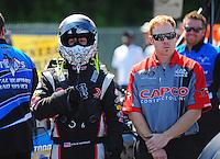 May 6, 2012; Commerce, GA, USA: NHRA top fuel dragster driver Steve Torrence with crew member during the Southern Nationals at Atlanta Dragway. Mandatory Credit: Mark J. Rebilas-