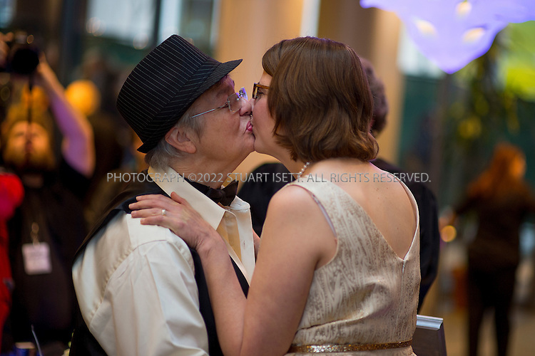 12/9/2012--Seattle, WA, USA..Karen Swanson (right), and Lynn Childs (left) getting married at Seattle City Hall...On the first day same sex couples were allowed to marry in Washington State, Hundreds of well-wishers braved cold and rain to celebrate 133 weddings at Seattle City Hall. Washington, Maine and Maryland last month became the first U.S. states to extend marriage rights to same-sex couples by a popular vote, in a leap forward for gay rights. A crowd of several hundred people waited outside City Hall in the cold to cheer couples as they descended the steps, some throwing bird seed, rice, blowing bubbles and handing flowers to the newlyweds...©Stuart Isett. All rights reserved.