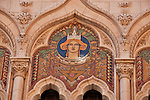 The mosaic of a woman wearing a crown on a building in Stockholm, Sweden