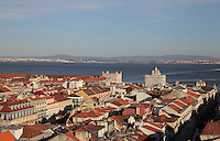 View over the rooftops of the Baixa district, with the Tagus river behind, Lisbon, Portugal. To the right is the top of the triumphal arch on the Placa de Commercio or Commerce Square. Picture by Manuel Cohen