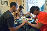 Eritrean asylum seekers pray before eating in their room in a church-run shelter in Freudenstadt, Germany. The Freundesdreis Asyl is run by Christlicher Kirchen, and managed by a retired United Methodist pastor. The shelter has 18 asylum seekers from Eritrea and 10 from Gambia. They came to Europe via Sudan and Libya, crossing the Mediterranean to Italy.