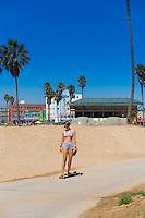 Girl on a skateboard, Venice beach, Los Angeles, California