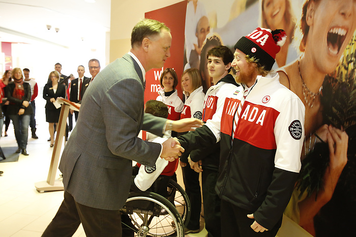 Ottawa, ON - March 28 2014- Member of Parliament for Ottawa South, David McGuinty, congratulates para-snowboarder John Leslie at the CIBC Paralympic Welcome Home Event at CIBC South Keys Banking Centre in Ottawa (Photo: Patrick Doyle/CIBC)