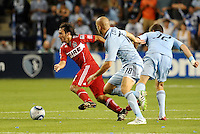 Gaston Puerari (red) Chiacgo Fire, Aurelien Collin (78) Luke Sassano (32) Sporting KC...Sporting KC were held to a scoreless tie with Chicago Fire in the inauguarl game at LIVESTRONG Sporting Park, Kansas City, Kansas.
