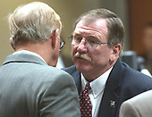 Prince William County prosecutors Richard A. Conway, right, and Paul Ebert talk during the trial of sniper suspect John Allen Muhammad in courtroom 10 at the Virginia Beach Circuit Court in Virginia Beach, Virginia, Wednesday October 22, 2003. Muhammad decided to allow his attorney's to represent him during his trial. <br /> Credit: Davis Turner - Pool via CNP