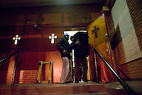 New York, USA - Church members carry loudspeakers out of the Greater Hood Memorial AME Zion Church, home of the Hip-Hop Church, in Harlem, New York, USA, 10 February 2005, after mass. Photo Credit: David Brabyn.