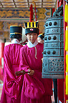Student plays traditional bronze bell, Cishan Confucius Ceremony Cishan District, Kaoshiung , Taiwan