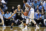 28 December 2016: Monmouth's Justin Robinson (12) guards North Carolina's Seventh Woods (right). The University of North Carolina Tar Heels hosted the Monmouth University Hawks at the Dean E. Smith Center in Chapel Hill, North Carolina in a 2016-17 NCAA Division I Men's Basketball game. UNC won the game 102-74.