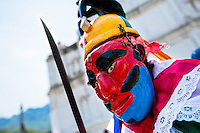 "A member of a dance group ""Los Historiantes"" performs the Dance of the Moors and Christians during the Flower & Palm Festival in Panchimalco, El Salvador, 8 May 2011. On the first Sunday of May, the small town of Panchimalco, lying close to San Salvador, celebrates its two patron saints with a spectacular festivity, known as ""Fiesta de las Flores y Palmas"". The origin of this event comes from pre-Columbian Maya culture and used to commemorate the start of the rainy season. Women strip the palm branches and skewer flower blooms on them to create large colorful decoration. In the afternoon procession, lead by a male dance group performing a religious dance-drama inspired by the Spanish Reconquest, large altars adorned with flowers are slowly carried by women, dressed in typical costumes, through the steep streets of the town."