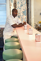 Andr&eacute; Saraiva's new Cafe Henri  in Chinatown. At the counter is the chef Marquis Hayes. <br /> <br /> Danny Ghitis for The New York Times