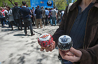 "Happy hockey fans and other visitors get free promotional cupcakes in Madison Square Park in New York at the kick-off of the partnership between the NHL and Crumbs Bake Shop on Tuesday, April 30, 2013. Crumbs Bake Shop will be selling National Hockey League ""Stanley Cupcakes"" with the NHL and team specific logos. The promotional campaign, with the NBC Sports Group also in the partnership, leads up to the 2013 Stanley Cup Playoffs. (© Richard B. Levine)"