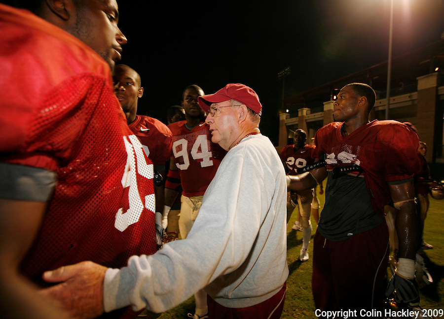 TALLAHASSEE, FL 11/3/09-FSU-ANDREWS RETIRE CH11-Florida State Defensive Coordinator Mickey Andrews is surrounded by his players after he announced that he will retire Feb. 10, 2010, Tuesday during a news conference in Tallahassee. ..COLIN HACKLEY PHOTO