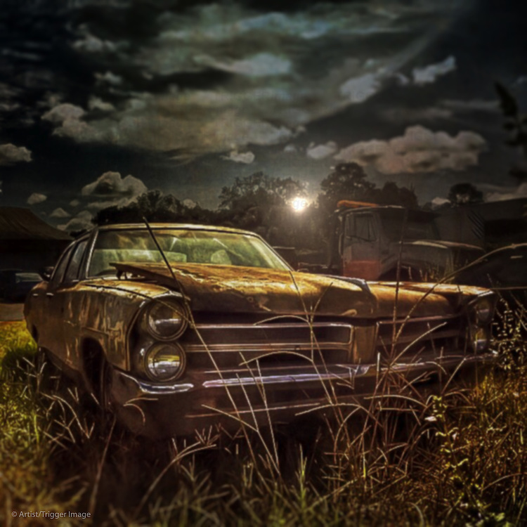 Classic car rusting in the countryside