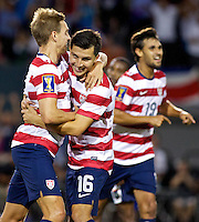 PORTLAND, Ore. - July 9, 2013: Stuart Holden and Jose Torres react after Holden's goal in the second half. The US Men's National team plays the National team of Belize during the 2013 Gold Cup at at JELD-WEN Field.