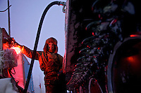 Andrei fills up his snow tank with diesel at a camp set up by oil and gas prospecting company Siesmorevzedka in the Arctic tundra. /Felix Features