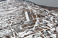 Isle-aux-Grues airfield is pictured in this aerial photos  March 19, 2010.    The only inhabited island among the twenty-one which make up the Isle-aux-Grues archipelago, Isle-aux-Grues is an island situated on the Saint Lawrence River, measuring approximately 7 kilometres by 2 kilometres.