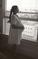 Sandra while pregnant looking out the window.