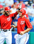 10 March 2012: Washington Nationals' third baseman Ryan Zimmerman is greeted by Jayson Werth as he comes home to score during action against the New York Mets at Space Coast Stadium in Viera, Florida. The Nationals defeated the Mets 8-2 in Grapefruit League play. Mandatory Credit: Ed Wolfstein Photo