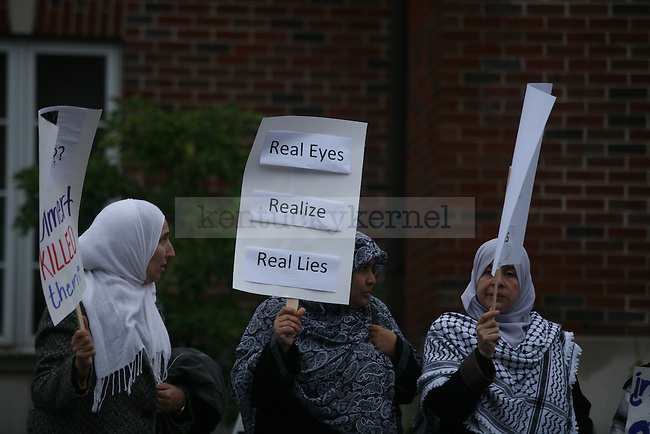 Palestinian and Palestinian supporters gathered Wednesday evening to protest the speech by former Israeli Prime Minister Ehud Olmert, who spoke about peace and his time as prime minister during his visit to UK on Wednesday, Oct. 14, 2009 at the Singletary Center for the Arts.