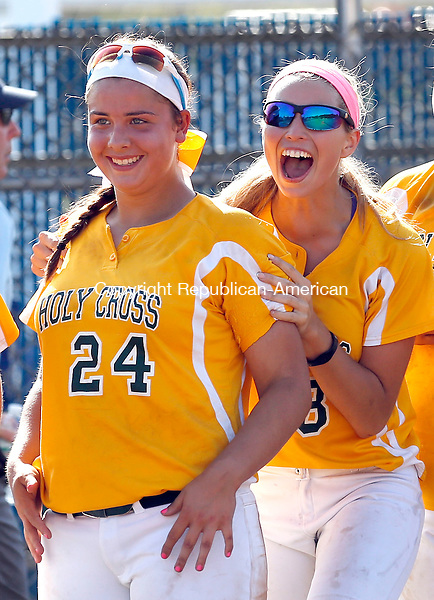 West Haven, CT- 10 June 2015-061015CM05- Holy Cross'   Sarah Lawton #24 and Sydney McIldowie #8 celebrate after defeating East Granby 2-0 in the Class S semi-final game in West Haven on Wednesday.   Christopher Massa Republican-American