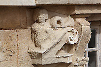 Sculptural detail of a scroll and figure, badly weathered, on the Phare de Cordouan or Cordouan Lighthouse, built 1584-1611 in Renaissance style by Louis de Foix, 1530-1604, French architect, located 7km at sea, near the mouth of the Gironde estuary, Aquitaine, France. This is the oldest lighthouse in France. There are 4 storeys, with keeper apartments and an entrance hall, King's apartments, chapel, secondary lantern and the lantern at the top at 68m. Parabolic lamps and lenses were added in the 18th and 19th centuries. The lighthouse is listed as a historic monument. Picture by Manuel Cohen