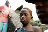 Sierra Leone. Freetown. Homeless boy who uses to be a soldier of the RUF (Revolutionary United Front) rebels during the war. He has no job and live with a group of ex-soldiers mostly children in the streets near the harbour. © 2002 Didier Ruef