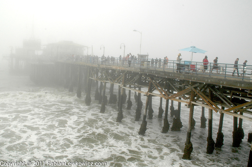 A blanked of fog sweeps past the Santa Pier on Tuesday, March 15, 2011.