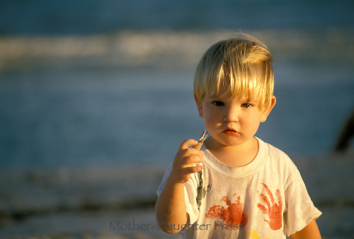 Young boy on beach in northern florida on the gulf coast seems puzzled by the crab claws he has found. He is asking us about the oceans-- and now perhaps, the oil