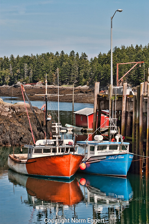 Two Fishing boats tied up at the wharf at Head Harbor, Campobello, New Brunswick, Canada (vertical)