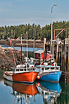 Two Fishing boats tied up at the wharf at Head Harbor, Campobello, New Brunswick, Canada (vertical)