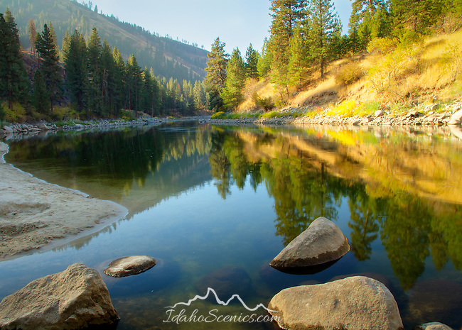 Idaho, West central, Banks. A serene autumn morning with reflections on a calm stretch of the Payette River.