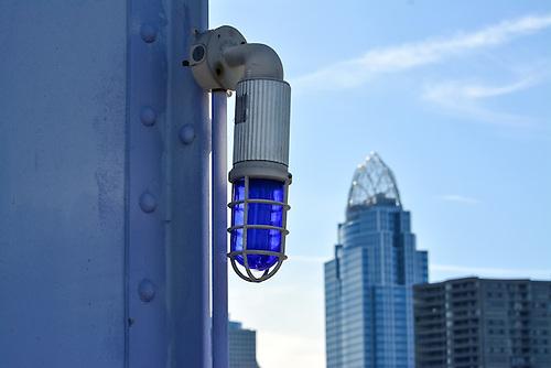 "Blue light on the ""Purple People Bridge"" in between Newport, Kentucky and Cincinnati, Ohio."