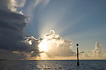 Cook's Bay, Moorea, French Polynesia; sunset views of the channel marker from the edge of Cook's Bay channel, shot after scuba diving from boat , Copyright © Matthew Meier, matthewmeierphoto.com All Rights Reserved