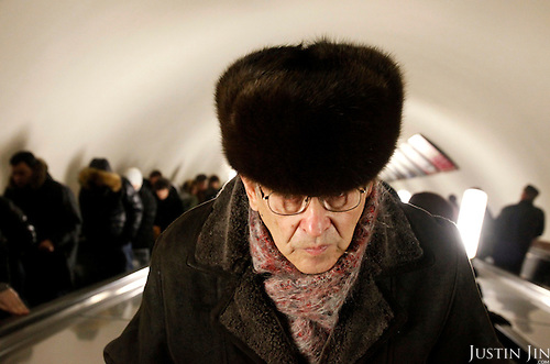 A man on the escalator inside the Paveletskaya station on the Moscow Ring Line. The Moscow Metro, which spans almost the entire Russian capital, is the world's second most heavily used metro system after the Tokyo's twin subway. Opened in 1935, it is well known for the ornate design of many of its stations, which contain outstanding examples of socialist realist art.