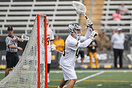 Towson, MD - March 25, 2017: Towson Tigers Josh Miller (49) clears the ball during game between Towson and Denver at  Minnegan Field at Johnny Unitas Stadium  in Towson, MD. March 25, 2017.  (Photo by Elliott Brown/Media Images International)