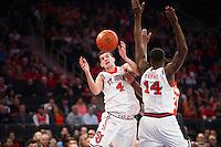 NEW YORK, NY - Sunday December 13, 2015: Federico Mussini (#4) of St. John's scrambles for the ball.  St. John's defeats Syracuse 84-72 during the NCAA men's basketball regular season at Madison Square Garden in New York City.