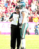 Philadelphia Eagles head coach Andy Reid, left, discusses strategy with guard/tackle Todd Herremans (79) in the fourth quarter against the Washington Redskins at FedEx Field in Landover, Maryland on Sunday, October 16, 2011.  The Eagles won the game 20 - 13..Credit: Ron Sachs / CNP