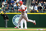 Los Angeles Angels center fielder Mike Trout rounds second base after hitting a solo home run to center field off Seattle Mariners'  starting pitcher Felix Hernandez in the first inning of season home opener April 6, 2015 at Safeco Field in Seattle.  The Mariners beat the Angels 4-1.     ©2015. Jim Bryant Photo. ALL RIGHTS RESERVED.